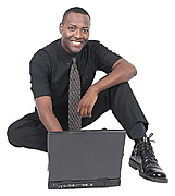 black_man_working_sitting_on_floor